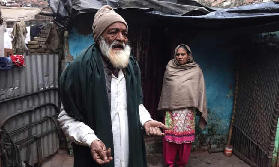 Mohammad Sharif, 74, and his wife, in front of their hut in Kanpur, Uttar Pradesh. The couple's son, Mohammad Raees, was shot dead by police.