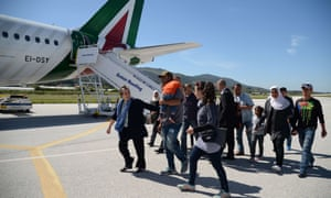 A group of Syrian refugees arrive to board a plane to travel to Italy with Pope Francis