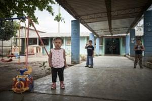 Children are seen at the Penitenciaria Nacional Femenina de Adaptación Social, a women-only prison in Tamara, Honduras