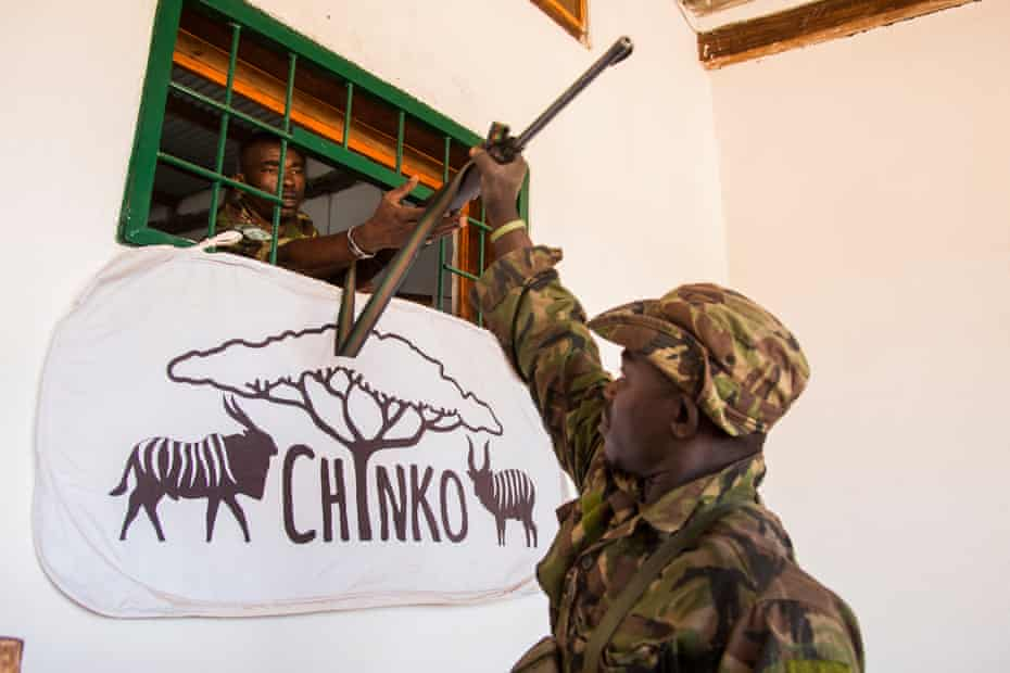 Dieudonné, a ranger, returns from patrol and hands his weapon over to senior ranger Saint-Cyr in Chinko's armoury.