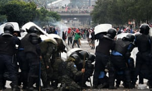 Opposition supporters clash with soldiers and riot police in Tegucigalpa.