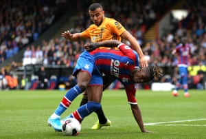 Romain Saïss was sent off for two challenges on Crystal Palace's Wilfried Zaha.