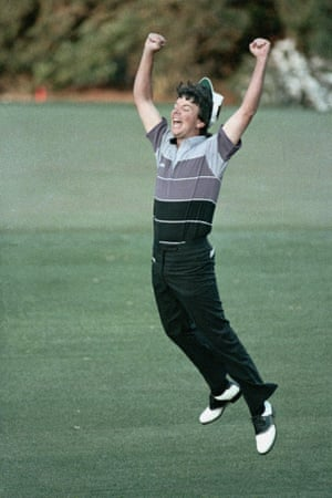 Larry Mize jumps high in the air after sinking a 40-yard chip during the second hole of sudden death to win the 1987 Masters.