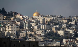 An Israeli flag flutters in front of the Dome of the Rock, seen from the Palestinian village of Abu Dis.