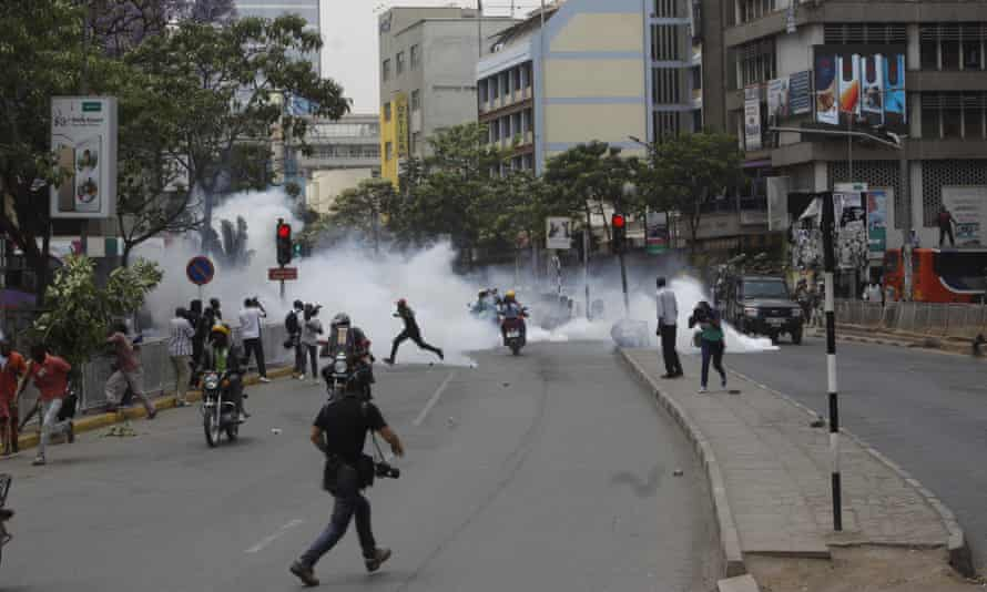 Riot police fire teargas against opposition supporters during a demonstration in Nairobi on Wednesday