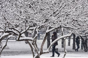 A man walks on a snow covered street during heavy snowfall in Skopje, Macedonia.