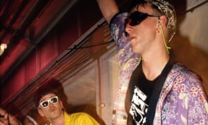 Two guys raving in shades