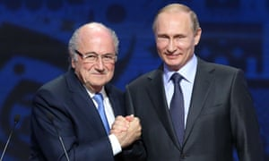 Vladimir Putin with former Fifa president Sepp Blatter at last year's preliminary draw for the 2018 World Cup qualifiers.