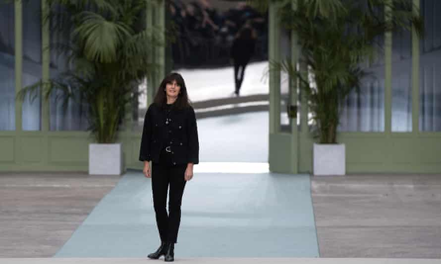 French fashion designer Virginie Viard acknowledges the audience at the end of the show.