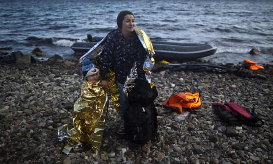 A Syrian woman and child on the Greek coast