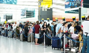 People queue inside terminal 5 at Heathrow airport.