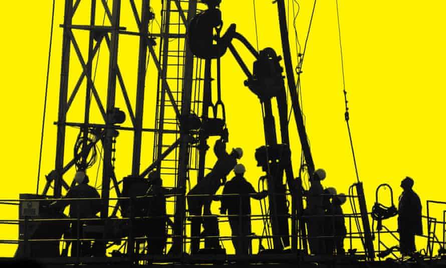 Iraqi workers pump oil at the Shirawa oilfield