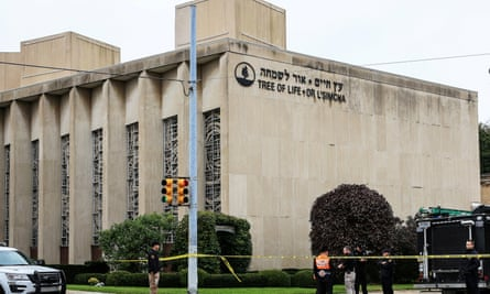 Police officers guard the Tree of Life synagogue following the shooting