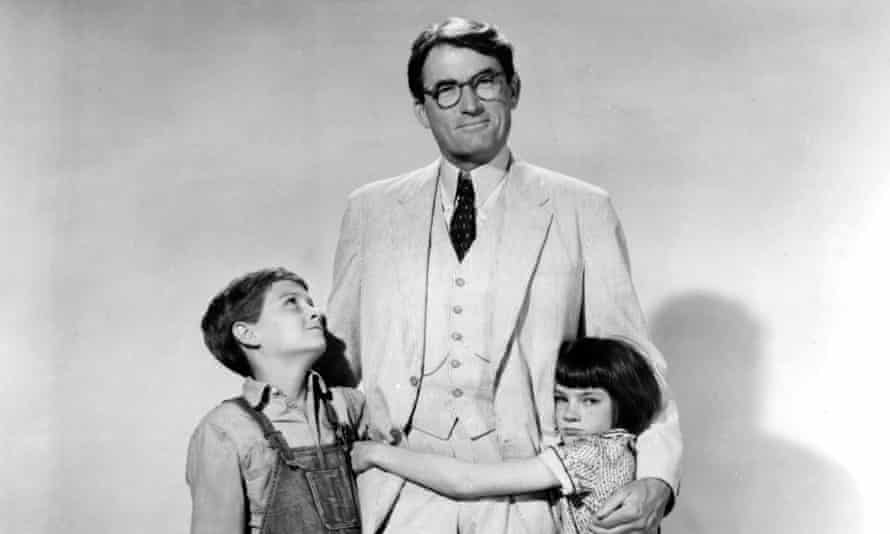 Gregory Peck as Atticus Finch, Mary Badham as Jean Louise 'Scout' Finch and Phillip Alford as Jeremy 'Jem' Finch in To Kill a Mockingbird.