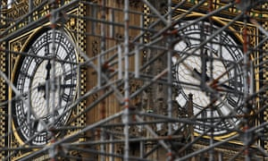 Scaffolding supplied by Sir Robert McAlpine surrounds the clock face on the Elizabeth Tower at the Palace of Westminster.