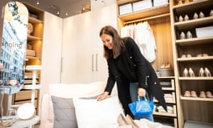 A customer looks at bedding in the new Ikea Planning Studio in central London