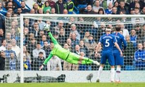 Chelsea's Kepa Arrizabalaga keeps out a Watford effort.