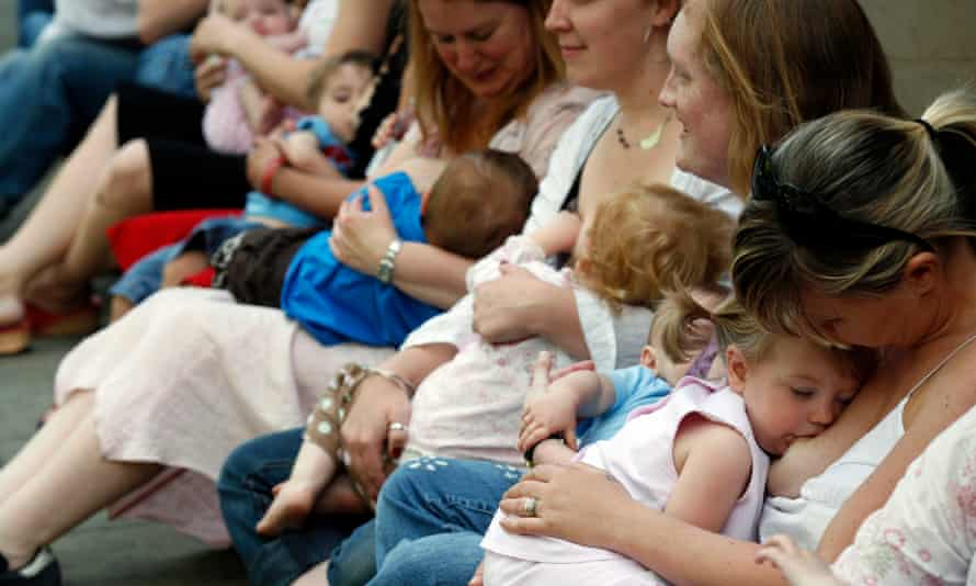 Mothers breastfeed babies at a 'breastfeed-a-thon' photo-call at the Church House Conference Centre, London, to celebrate National Breastfeeding Awareness Week.