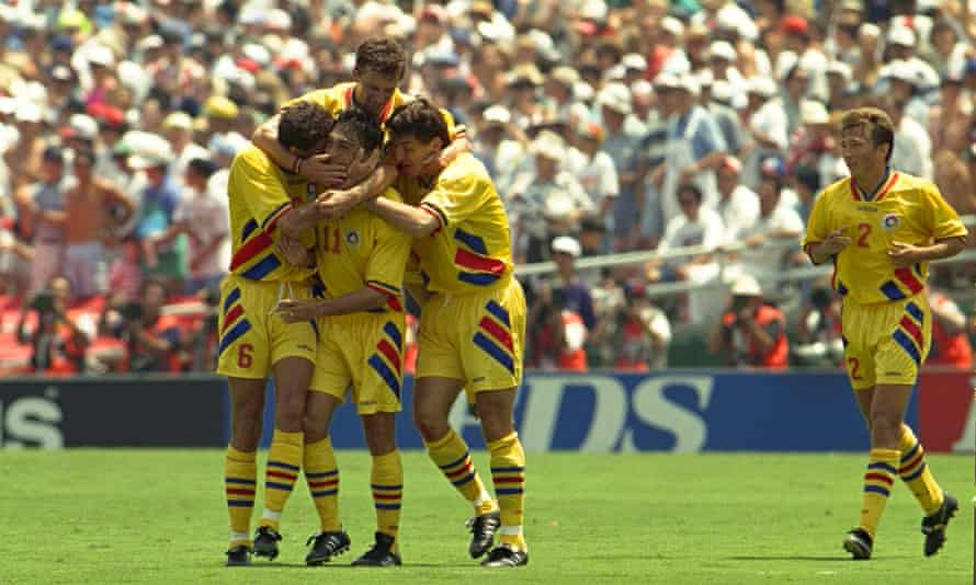 Romania players celebrate after Ille Dumirescu's goal.