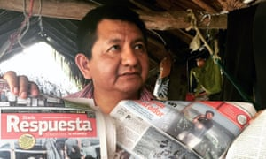 Mexican journalist Pedro Canché shows headlines containing false accusations against him.