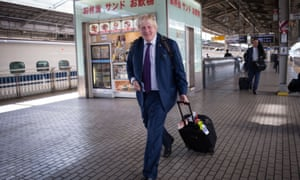 Boris Johnson  at Osaka railway station in Japan