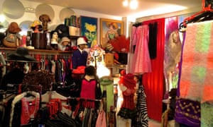 Inside Vintage Icons & Echoes, with racks of clothes, hats etc