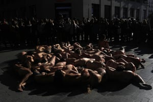 Madrid, Spain: animal rights activists Anima Naturalis stage a naked protest against the use of leather and fur in the textile industry