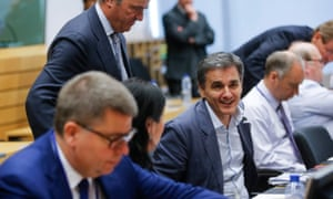 Euclid Tsakalotos, centre, at a meeting of eurozone finance ministers in Brussels