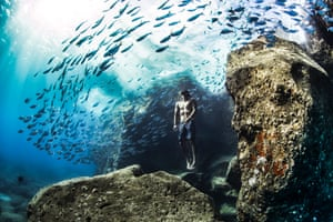 Andre Fajardo free diving early one summer morning, Hawaiian Islands: gold prize in the human and nature category