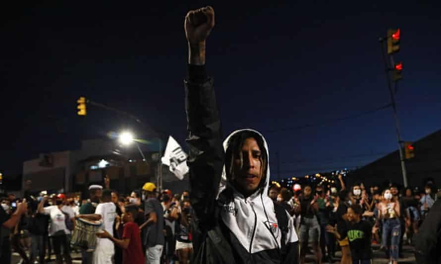 A man raises his fist during a protest against the death of Joao Alberto Silveira Freitas in Porto Alegre, Brazil on Monday.