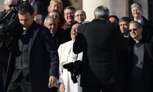 Pope Francis shares a joke in St Peter's Square.