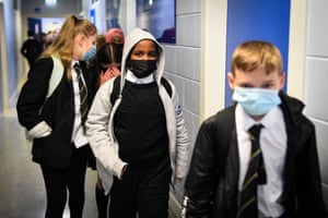 Glasgow, Scotland. Pupils wear face masks as they walk in a corridor at Springburn academy
