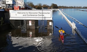 "A man kayaks on a flooded Worcester racecourse after Storm Bella""brought gales and heavy rain to the West Midlands."