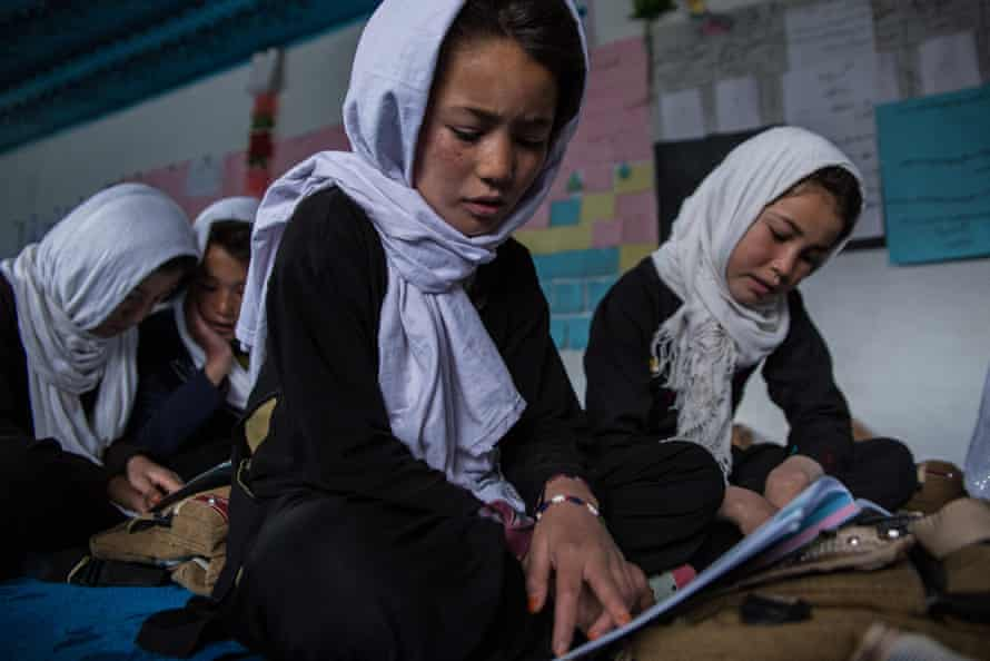 Children attend a school in Garmaab Olya Village, Lal District, Ghor Province, Afghanistan.