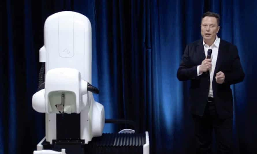 elon musk with the surgical robot from his august 2020 neuralink presentation