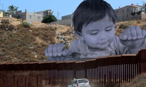 A US Border Patrol vehicle travels past the installation. 'Kikito's famous now,' says a Mexican visitor.