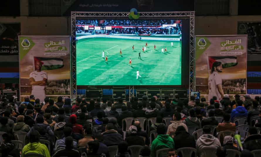 Fans in Gaza watch an Asian Cup match between Syria and Palestine on a big screen.