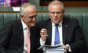 Australian Prime Minister Malcolm Turnbull speaks to Australian Treasurer Scott Morrison during House of Representatives Question Time, 2016