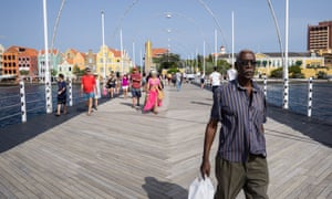 The Dutch-style architecture of Willemstad is a draw for the tourists who mingle unwittingly with Venezuelan migrants in Curaçao.