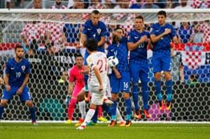 David Silva's free-kick hits the wall.