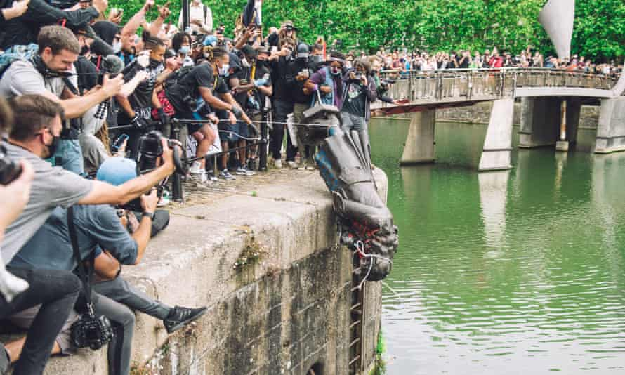 The statue of Edward Colston is pushed into the river Avon in Bristol in June