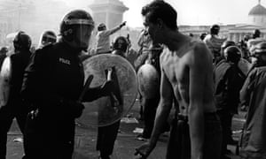 Police and demonstrators in Trafalgar Square during the anti-poll tax riots of April 1990
