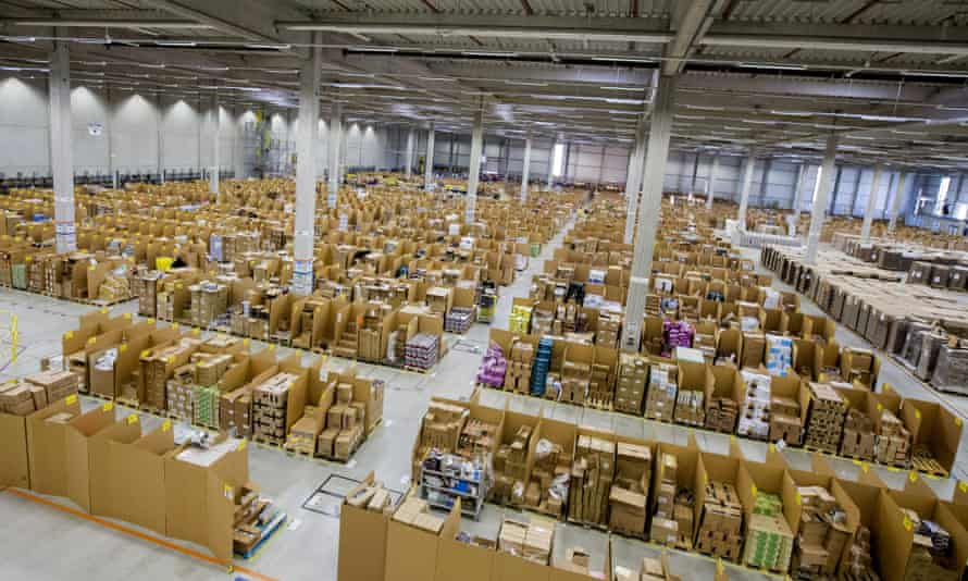 Boxes and parcels sit stacked in bays ahead of shipping from the warehouse of an Amazon.com Inc fulfilment centre in Koblenz, Germany