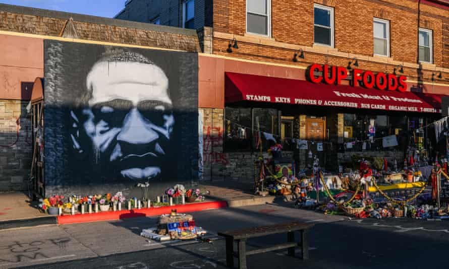 A mural of George Floyd is seen next to Cup Foods in Minneapolis, Minnesota, on 31 March.