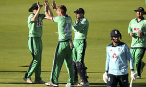 Ireland's Craig Young, second left, celebrates with teammates after taking the wicket of England's James Vince.