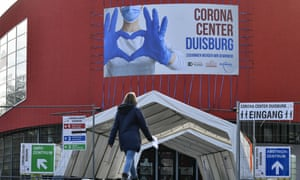 A woman approaches a concert hall repurposed as a vaccination centre in the city of Duisberg
