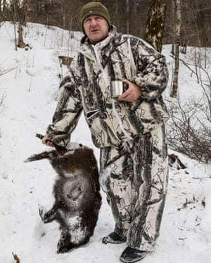 Fomenko with a frozen carcass of a wild boar.