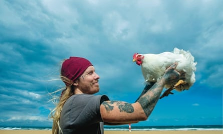 Animal rights activist Jareth at the beach with his rescue chicken Sephiroth – photographed for This Chicken Life