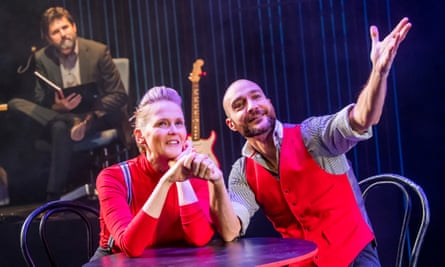 Dylan Emery as The Writer, background, with Pippa Evans and Justin Brett in Showstopper! The Improvised Musical.