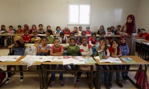 Teacher Hanan Anzi with Syrian refugee students  at one of the schools at Zaatari refugee camp